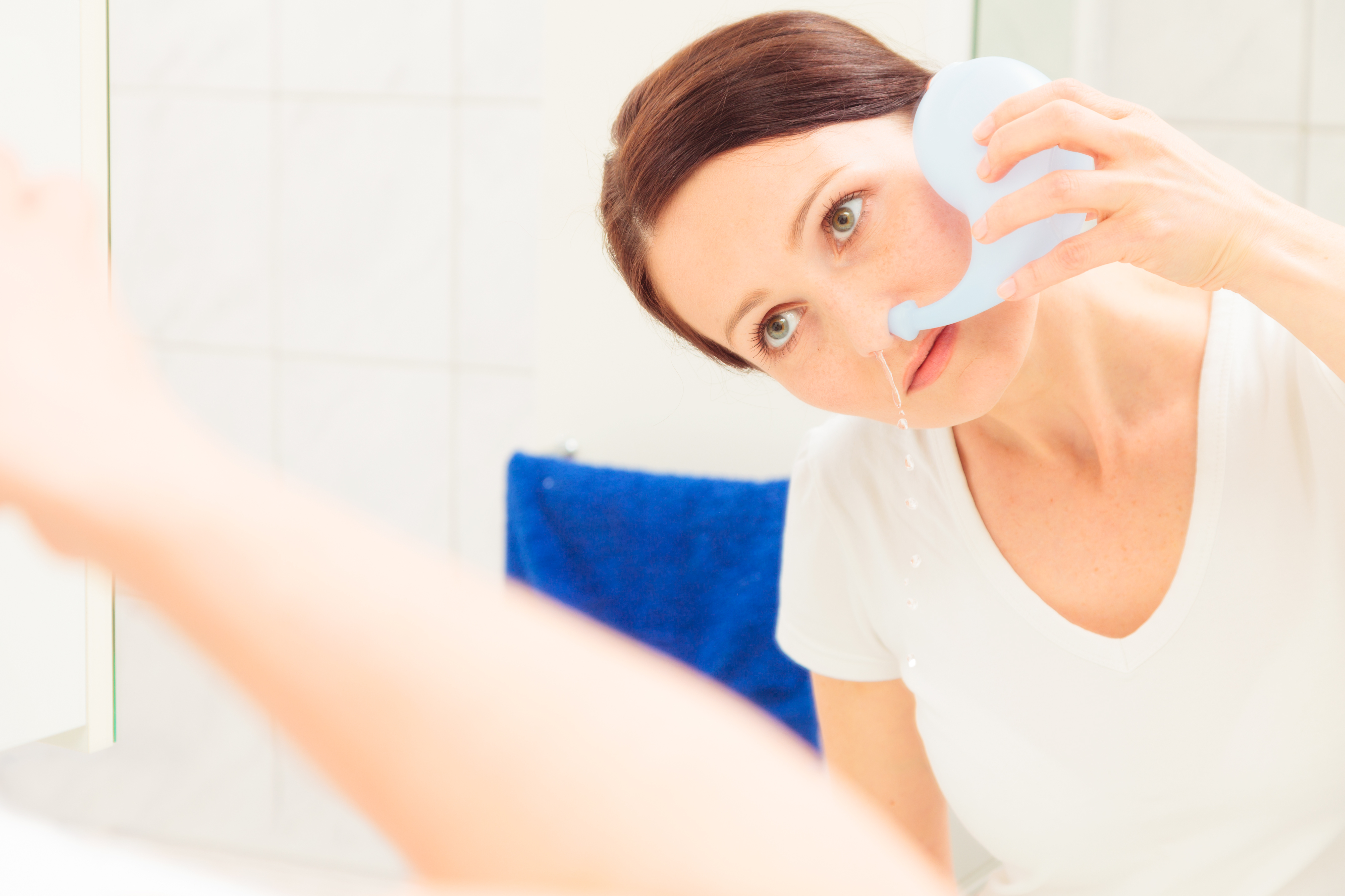 Woman Using Neti Pot For Nasal Irrigation After Rhinoplasty in Seattle, Bellevue, Kirkland