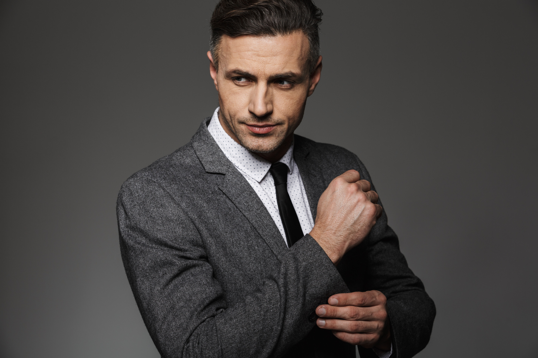 photo of stylish man wearing business suit